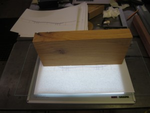 Paper template and alignment block on the light table.